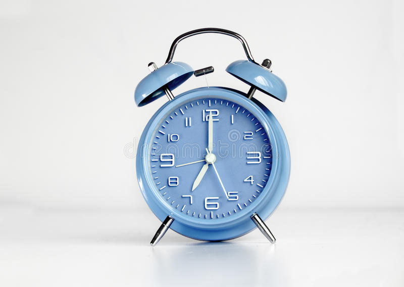 Blue analog retro twin bell alarm clock. Isolated stock images