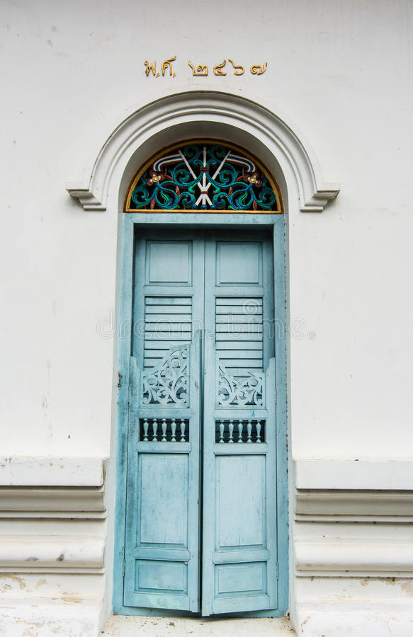 Blue ancient door. Of a monastery in Chanthaburi Thailand royalty free stock photography