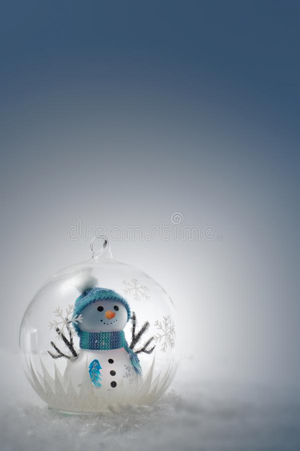 Free Blue And Green Snowman In A Globe With Snow Stock Images - 119666064