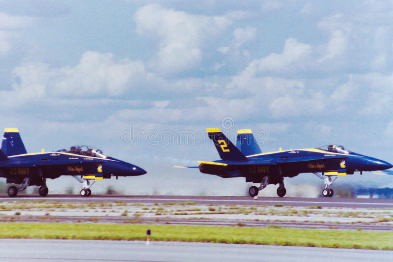 Blue Angels take off. The US Navy Blue Angels take off from Quonset Point, North Kingstown, RI. (Image taken from color slide royalty free stock photography