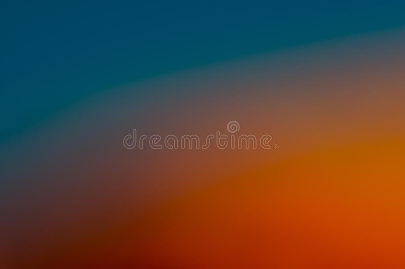 Blue, aquamarine, orange and brown smooth and blurred wallpaper / background. In pastel like colors in big resolution stock photo