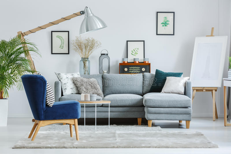 Download Blue Armchair On Grey Carpet Stock Photo