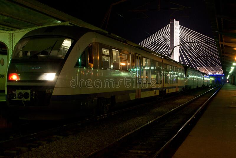 Blue Arrow Romanian train parked at Gara de Nord station. Basarab overpass is seen in the background. royalty free stock photos
