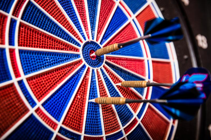 Blue arrows on dartboard stock photography