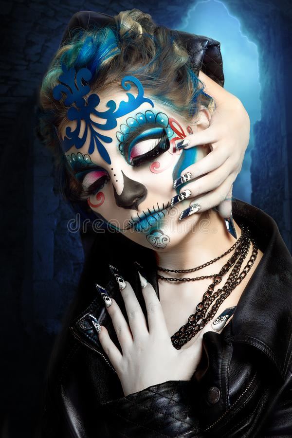 Blue art make up. New creative calavera is a representation of human skull. applied to decorative make up the Mexican celebration of the Day of the Dead Dia de stock images