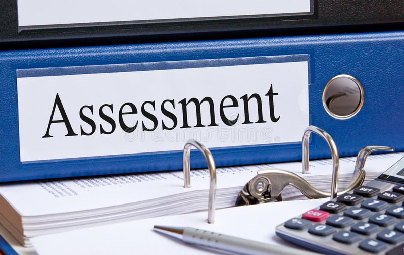 Blue assessment binder in office royalty free stock photo