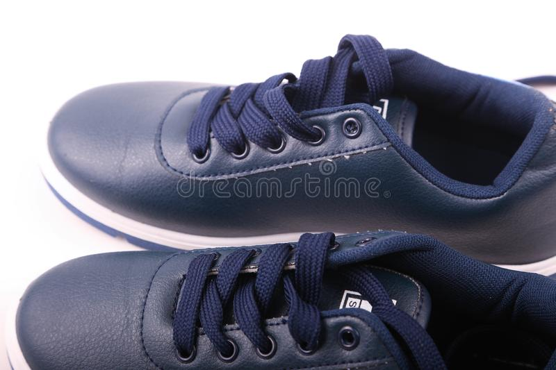 Blue Athletic Shoe close up. Pair of new blue Shoe sneakers close up over white background stock images
