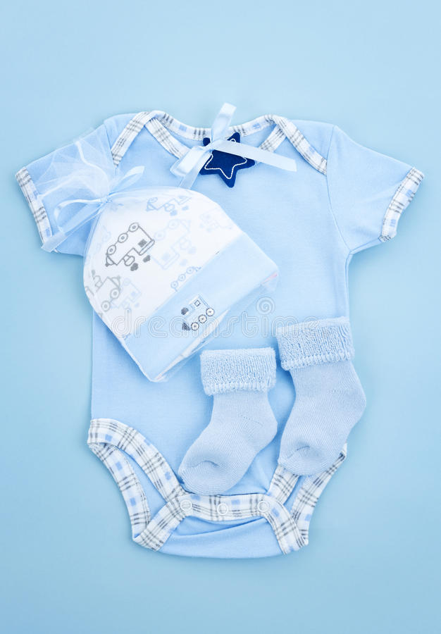 Blue baby clothes for infant boy stock photo