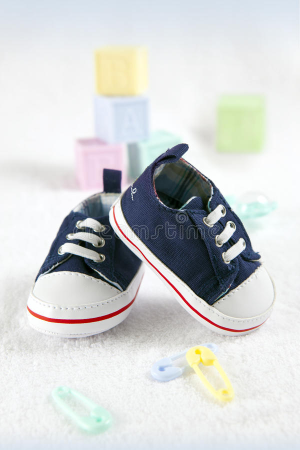 Blue baby shoes. Close-up of a blue baby shoes royalty free stock images