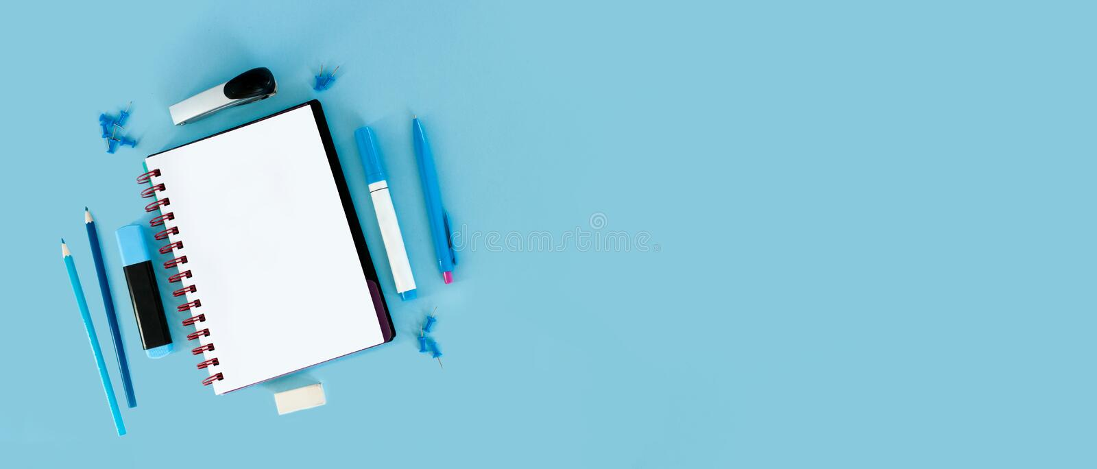 Blue background and blue school supplies. Back to school. Flat l. Ay. Creative Idea of education for banners. Sale posters. Blue background with copy space royalty free stock image