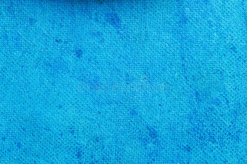 Blue background with canvas texture. Empty abstract surface for design royalty free stock photography