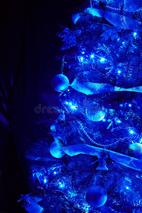 Blue background with christmas tree, ball, light. Abstract royalty free stock image