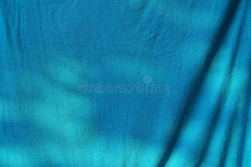 Blue cloth texture from a piece of crumpled cloth on clothes. Blue background of cloth from a piece of crumpled cloth on clothes royalty free stock image