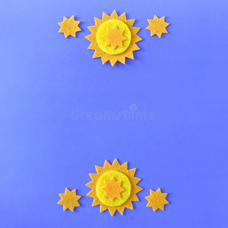 Blue Background with Yellow Stars and Copy Space. Blue background with copy space and yellow felt star ornaments, handmade crafting felt toy for children royalty free stock image