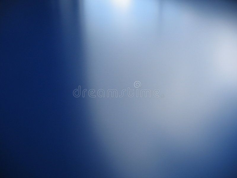 Blue background and gradient. A blue table top with a soft light and gradient