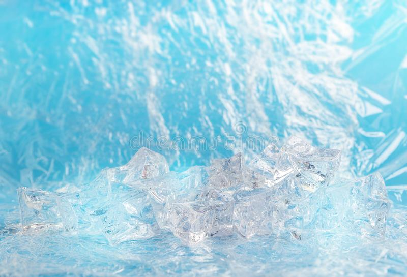 Blue background with group of ice cube. Fresh background with group of ice cube for product presentation in freshness or summer concept. Light blue color stock photo