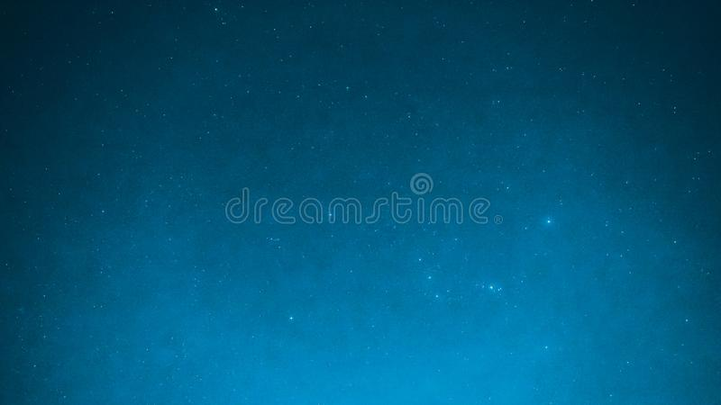 Blue background from night sky with bright small star and special seeing gemini meteor from northeast on december 14,2017 stock photography