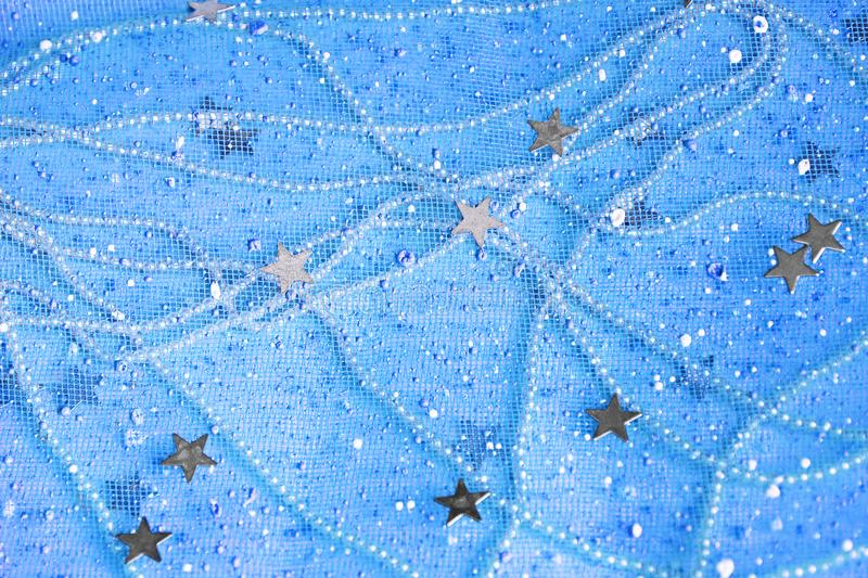 Blue background with pearls and stars stock photography
