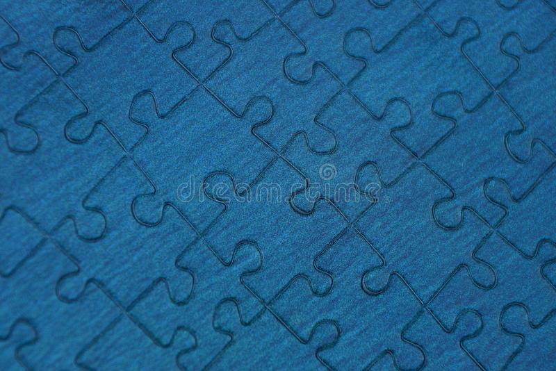 Blue background of a piece of paper puzzle royalty free stock photos