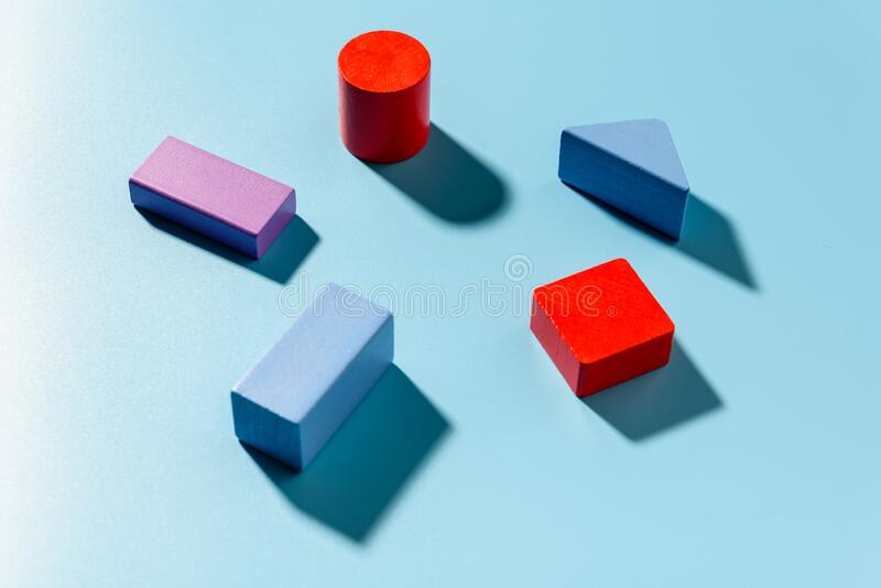 Blue background with red geometric figures casting shadows in a simple composition.  stock photos