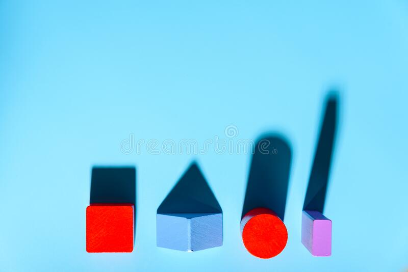 Blue background with red geometric figures casting shadows in a simple composition.  royalty free stock images