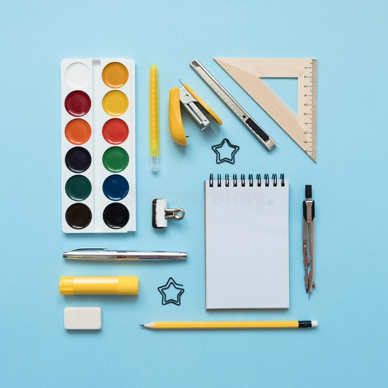 Blue background and yellow school supplies.  Back to school. Flat lay stock photography