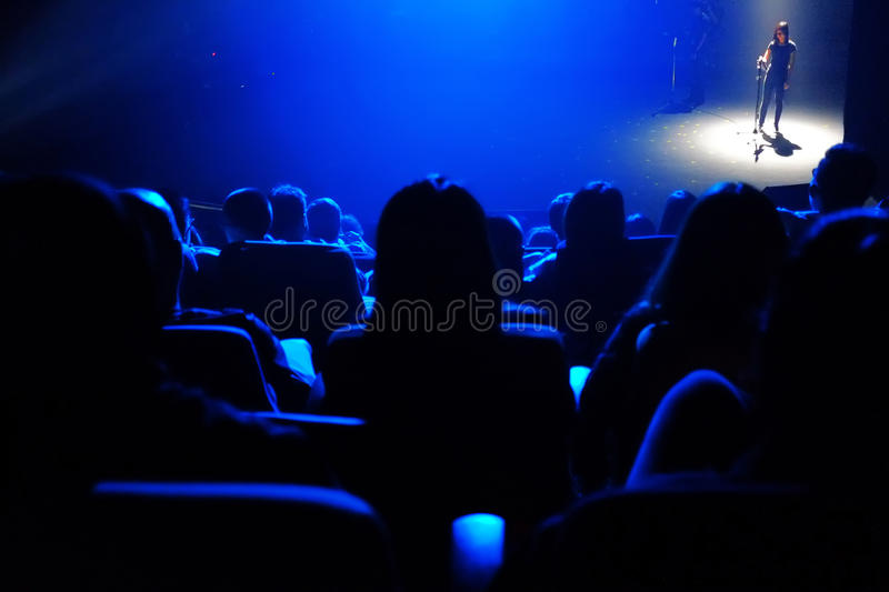 Blue of backlights. Blue back lights silhouettes of concert theater crowd and musical performer at Kuala Lumpur Performing Arts Centre or Pentas Seni Kuala stock photography