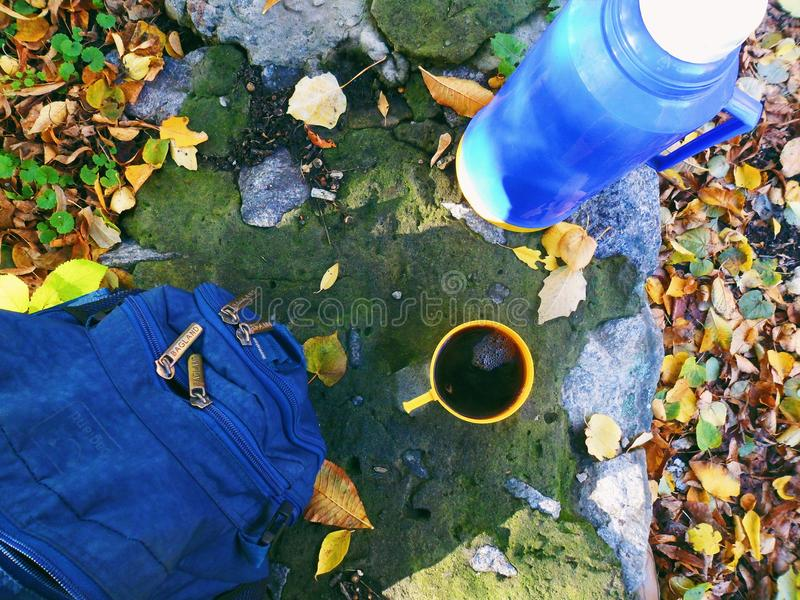 Blue backpack and coffee cup and thermos.  royalty free stock photos