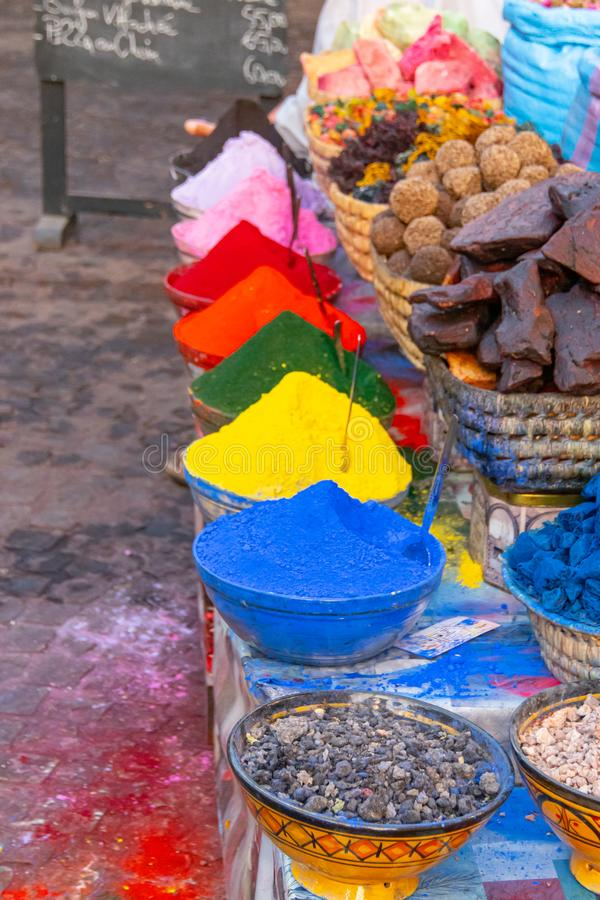 Blue bags with aromatic herbs and colored dyes in the Marrakech market stock image
