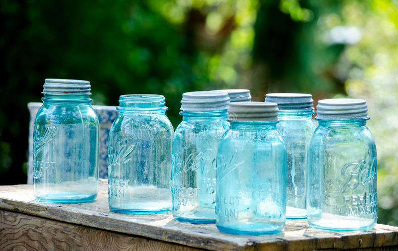 Blue ball canning jars. Antique blue ball canning jars gleam in the afternoon sunshine stock photos