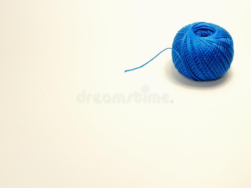 Blue ball of cotton thread for knitting stock photo