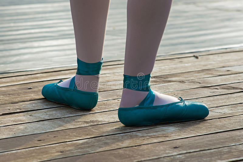 Blue ballet shoes with white socks in ballerina. royalty free stock photography
