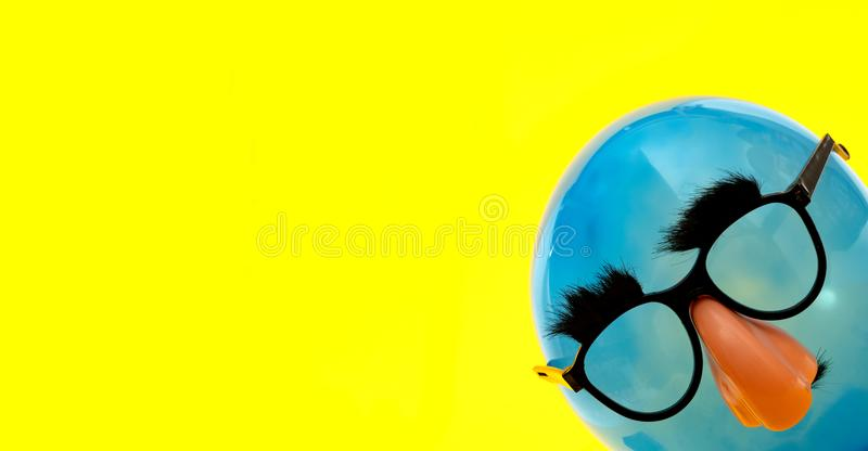 Blue Ballon with funny mask royalty free stock photos