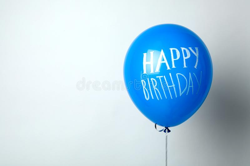 Blue balloon with words HAPPY BIRTHDAY. On white background stock image