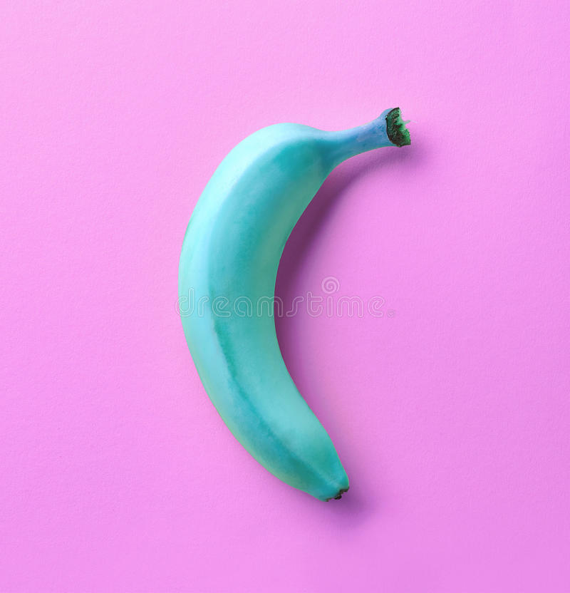 Blue banana on pink background royalty free stock images