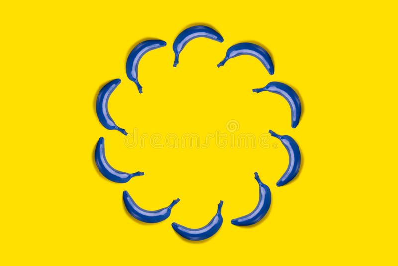 Blue banana on yellow background stock image