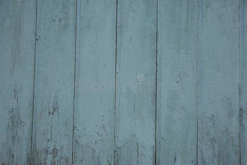 Blue barn wooden wall planking wide texture. Old wood slats rustic shabby background. Paint Peeled Azure Weathered Surface royalty free stock photos
