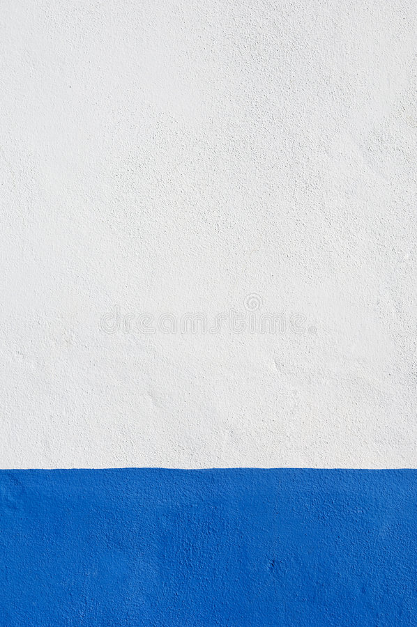 Blue baseboard. Detail of white wall with a nice deep blue baseboard stock images