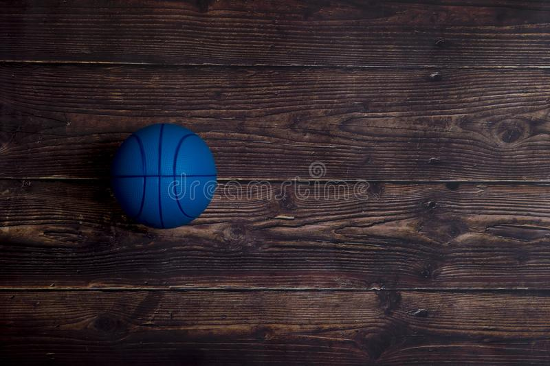 Blue Basketball On Old Hardwood Court Floor with Spot Lighting obrazy royalty free