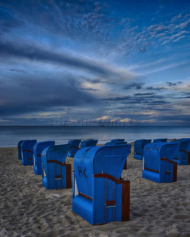 Blue beach chairs in evening light at the baltic sea. Rügen stock images