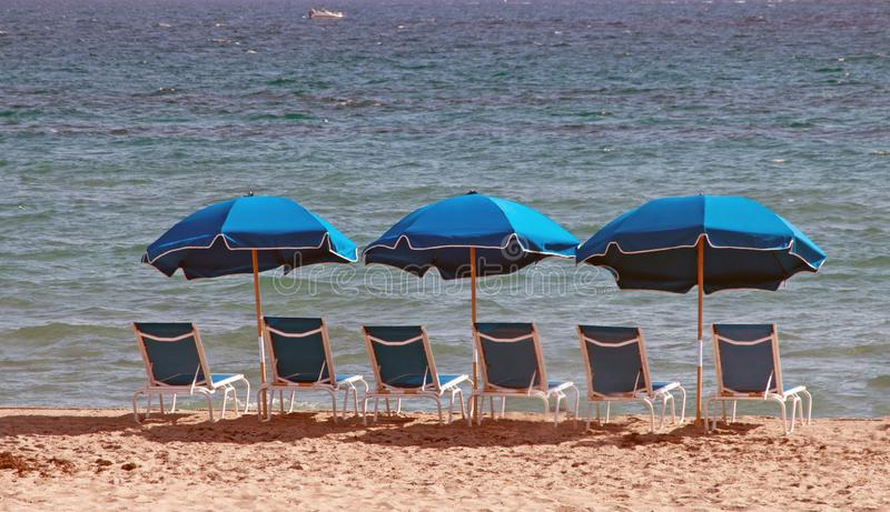 Blue Beach Chairs With Umbrellas stock photo