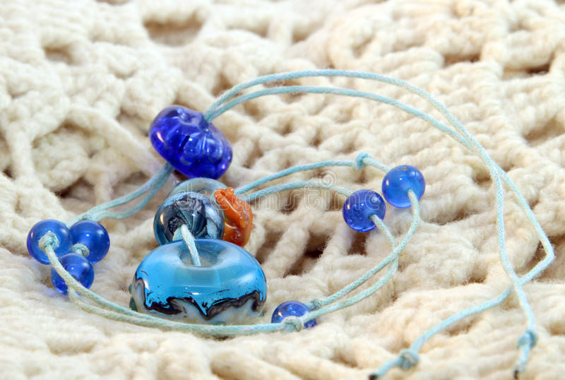Blue beaded pendant royalty free stock photo