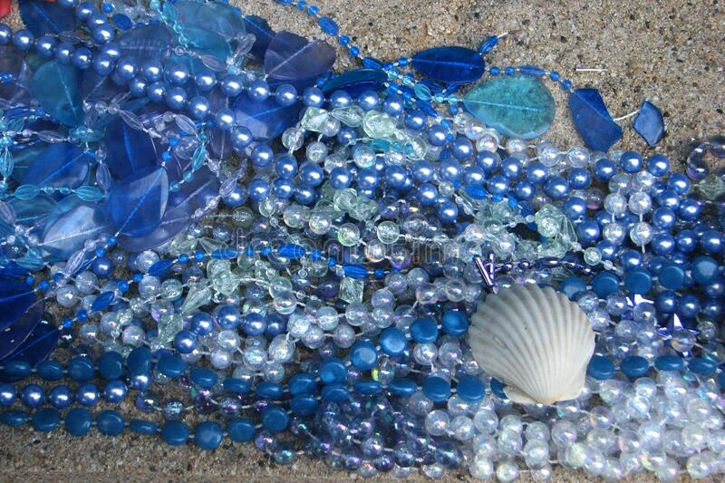 blue beads and glass with shell royalty free stock photos