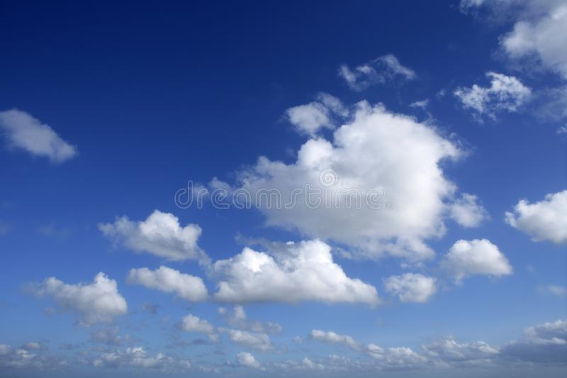 Blue beautiful sky with white clouds in sunny day. Blue beautiful sky with white clouds view in sunny day royalty free stock photos