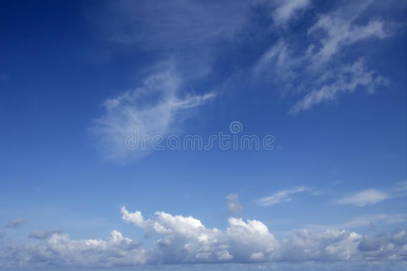 Blue beautiful sky with white clouds in sunny day royalty free stock images