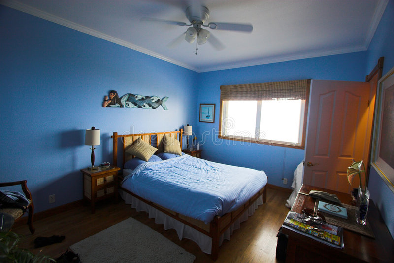 Blue bedroom. Blue painted bedroom in Hawaii's bed and breakfast royalty free stock photography
