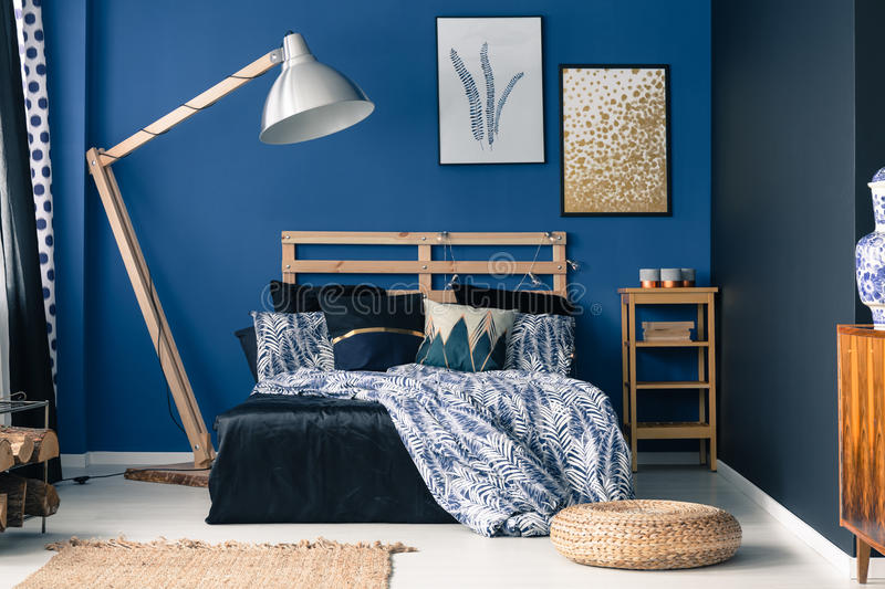 Blue bedroom, touch of gold stock photography