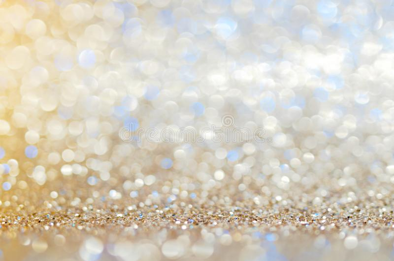 Blue,beige, Silver white abstract light background, shining lights, sparkling glittering Christmas lights. Blurred abstract holida royalty free stock images
