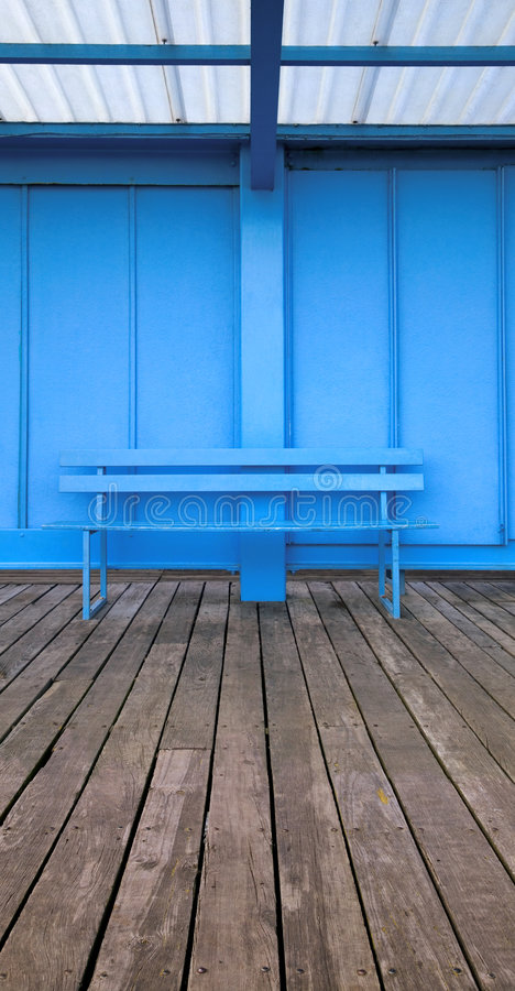 Blue bench royalty free stock photography
