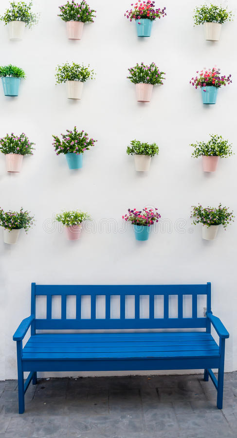 Blue bench with flower pots stock photography